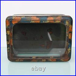 Antique shop display candy tin with glass showcase