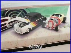 Hot Wheels 100% Rock'N' Road 4-car set 164 mounted in display showcase. Diecast